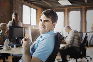 Image of man smiling in the office